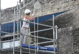 A young volunteer helping with restoration of the fortress