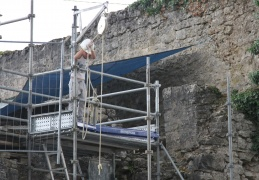 Young volunteer working on restoration of the fortress, Chatel