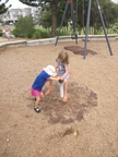 G pushing M at the playground, Kingscliff