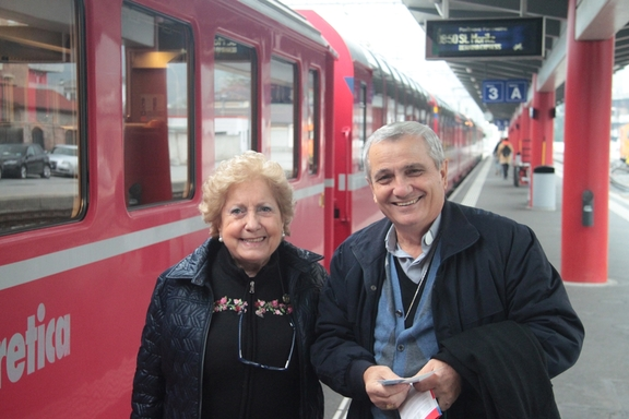 "Bishop Luciano Capelli and Amanda, boarding the ""Red Train"""
