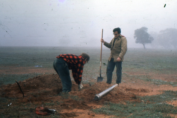 Digging trenches in the misty morning
