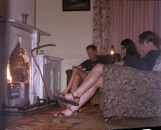 Enjoying a fire at Penny's holiday house in Blackheath; John Cunliffe in background