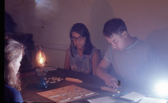 Scrabble by candle light during a blackout; Jo Gordon in foreground