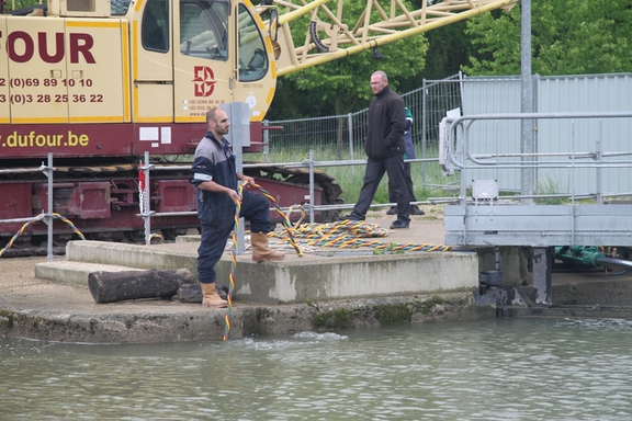 Divers clearing lock gates blocked by trees and stumps