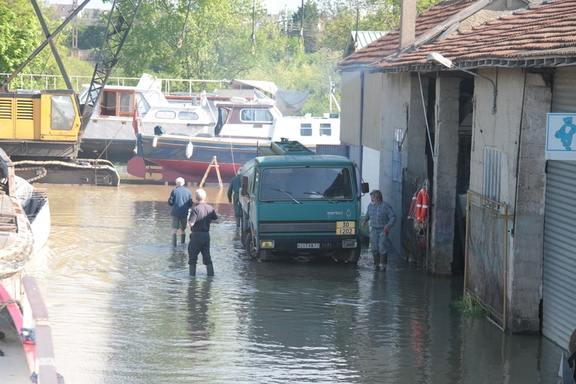 Wading through floodwater in the boatyard