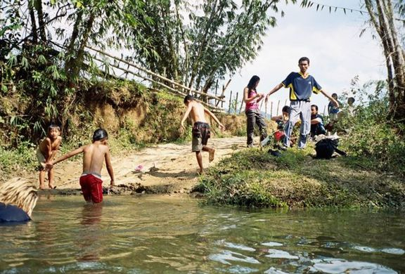 "Swimming at the river; the man is Mohhamoud aka ""MohQ"" or ""Moh"". The kids are students."