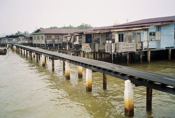 Kampong Ayer: literally the water village.The Mosque can be seen in the background.