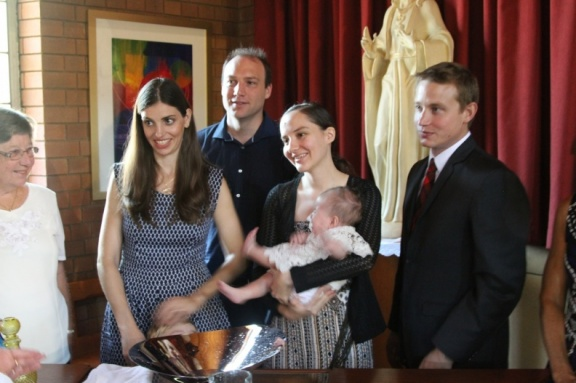 Godparents, parents and baby plus grandmother