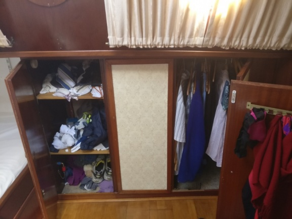 Wardrobe secured open for airing